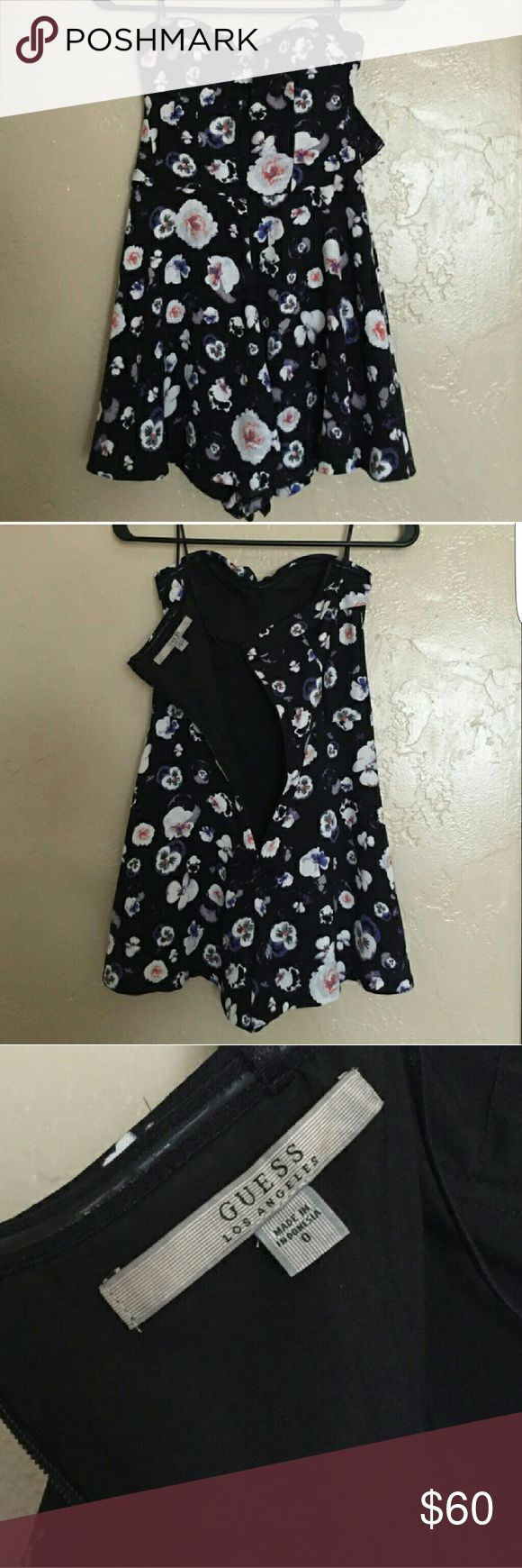 Guess Romper Black & Floral This romper is so cute!!! I purchased from a fellow posher and it fits perfectly except for the bra cup size. I would recommend for a full A cup or B cup (I'm barely an A). This is a serious steal - no flaws.   Zips in the back and comes with straps. Built in cups so there's no need for a bra! Guess Dresses Mini