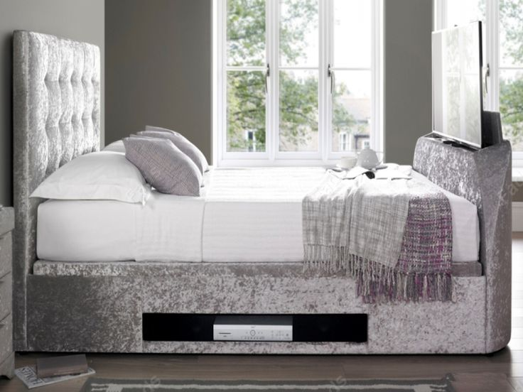 The Barnard silver crushed velvet TV ottoman bed has a compact design that is ideal for large or smaller rooms. Idea for de-cluttering your bedroom, the Barnard tv bed features a spacious floating floor storage area that is easily accessed by a side lift opening allowing easy access. - See more at: http://www.fads.co.uk/beds/fabric/barnard-silver-crushed-velvet-tv-ottoman-bed/#sthash.hzgOFWkl.dpuf