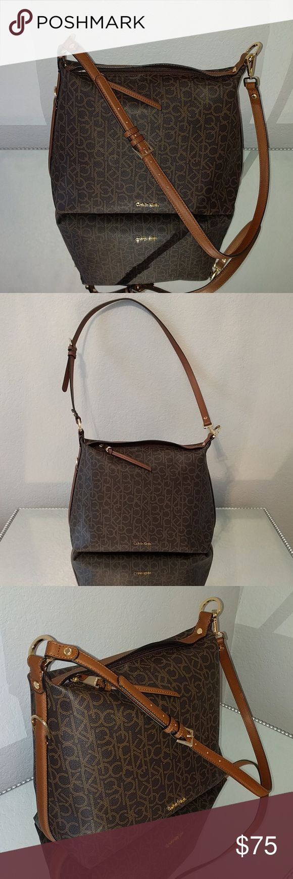 Calvin Klein Bag Brand New No Tags But Never Used Leather Calvin Klein Bag Adjustable Strap Medium Sized Bag Perfect As A Purse Or Use As A Weekender Bag For Travel Calvin Klein Bags