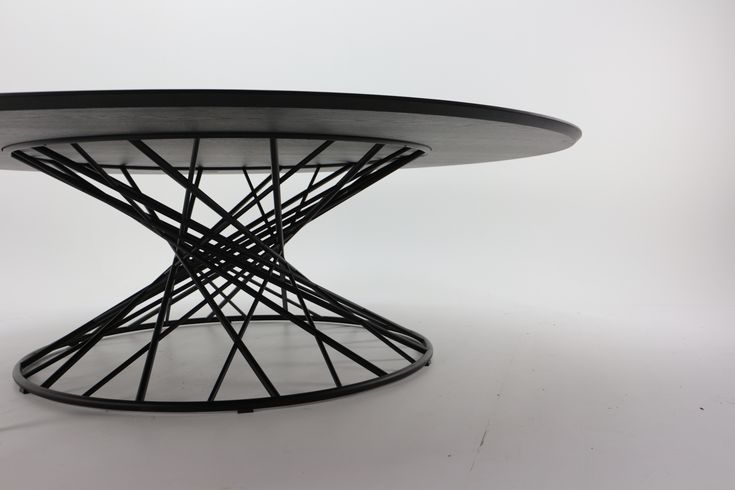 Lennart Van Uffelen his design Tafel 360 is an ode to mathematics: the perfectly lasercut tubing powder coated steel hyperboloid structure supports a massive 2 m 40 diametre oak table top. One of the more impressive tables ment to architecturaly impress on an object scale. #tafel#lennartvanuffelen#belgisch#design#maatwerk#furniture#belgiandesign#carpentry#metalwork#interieur#interiordesign#interiorstyle#interiorlovers#interiorarchitecture
