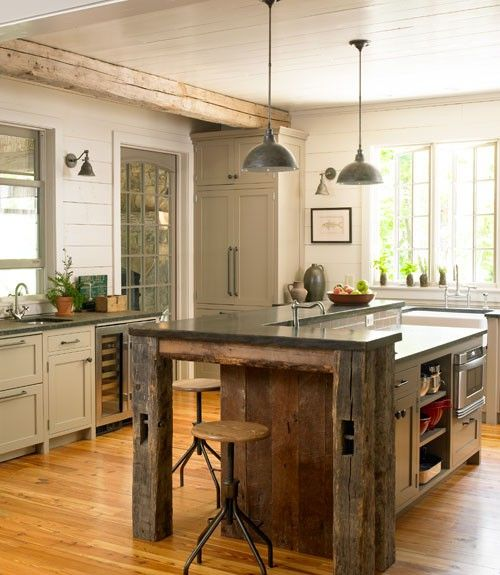 I would use some reclaimed wooden posts, or hand hewn type wood for accents on island, against stark white, modern lines.