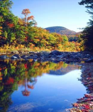 New Hampshire -    New Hampshire's White Mountains are a majestic sight to behold, set against this picturesque lake.   Photo: © Provided by Country Living