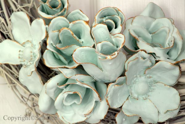 Silk flowers dipped in plaster-of-paris: You may have seen some plaster dipped items previously around the web.  But I quite like this idea and thought they warranted a little time in the spotlight.
