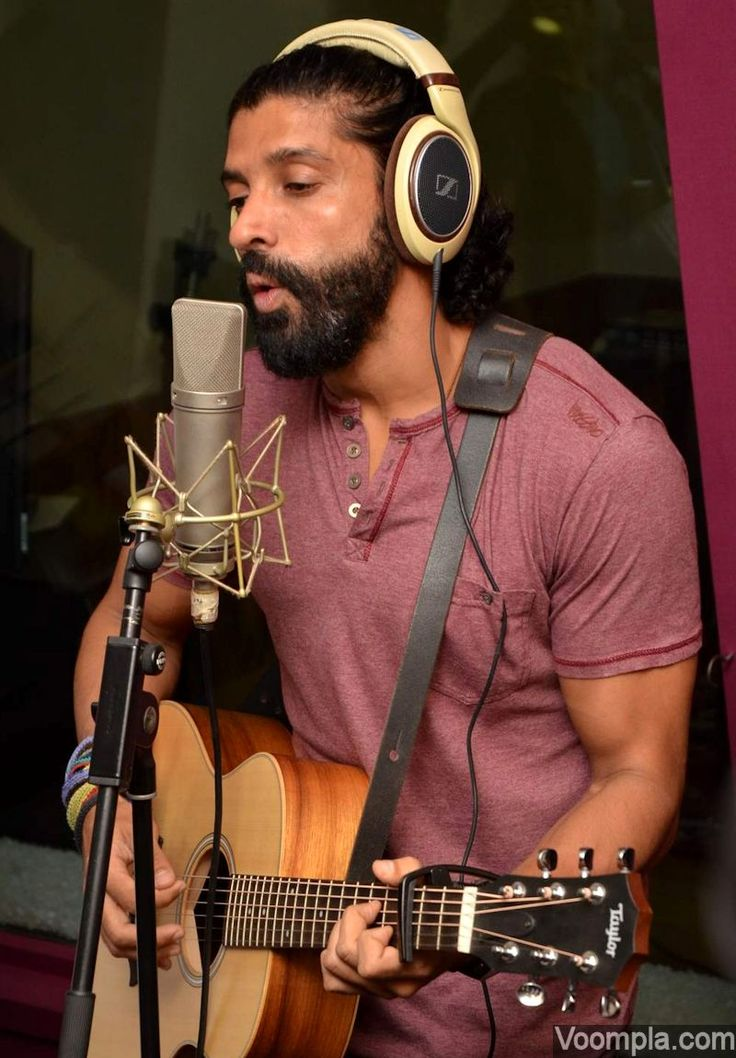 Bollywood heart-throb Farhan Akhtar pictured singing and strumming his guitar while recording a song in the studios. via Voompla.com