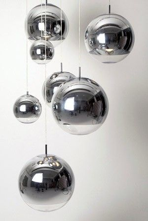 Tom Dixon Mirror Ball Available in large medium or small Mirror Ball suspension light by Tom Dixon. Made of plastic polycarbonate, the globe is metalised with real chrome metal, creating a mirror finish. Also available as standing lights, table lights, wall lights and floor lamps.