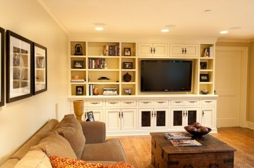 Off center space for tv, doors with speaker fabric in them, cabinets and open storage, nice combo