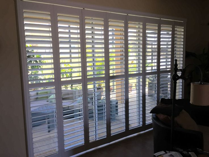 Gorgeous Bifold Plantation #Shutters For Patio Doors. Installation By  #BudgetBlinds #Clermont #