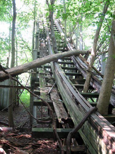 roller coaster hill  via: Nature Slowly Reclaims Abandoned Amusement Park | MetaFilter