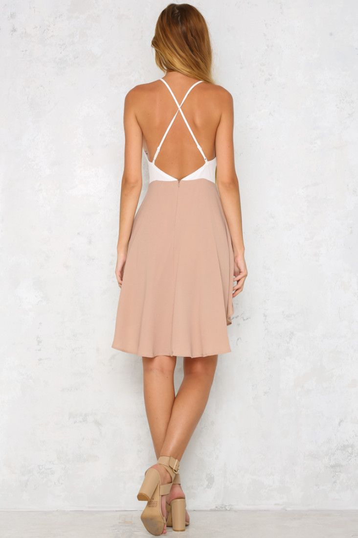 The Glowed Up Playsuit features a deep V neckline with partial boning and is supported on thin, adjustable straps that cross over at the exposed back. The shorts are floaty and there is an overlay of fabric that falls across the front and back. Complete your look with a pair of nude strappy heels!  Beige playsuit. Partially lined. Cold hand wash only. Model is standard XS and is wearing XS. True to size. Non stretchy fabric. Polyester.