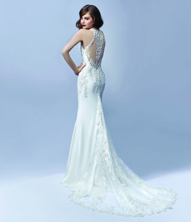 Enzoani bridalwear. Jaylee design from the Enzoani Blue 2017 collection.  Lace detailed low back wedding dress with lace straps and a lace insert train.