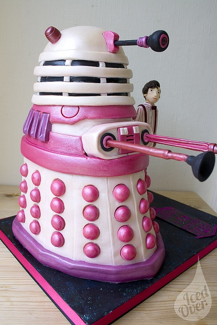 pink dalek cake. So you turn something aimed at destroying humans into a cute, harmless food. Then decide to feed it to your children? What are we coming to?????