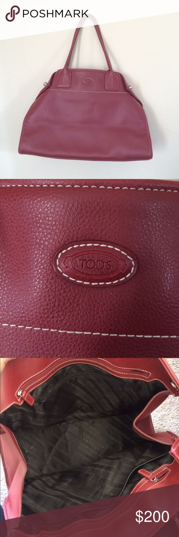 Tod's Girelli East West Bag Tod's Girelli east west bag. Super deep with tons of room. side clasps. Some wear on the front back that's not noticeable and some wear on the bottom. Hand me down, pretty sure it's authentic but not positive honestly. Tod's Bags