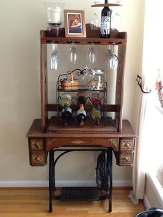 antique sewing machine with a wine glass holder hand made