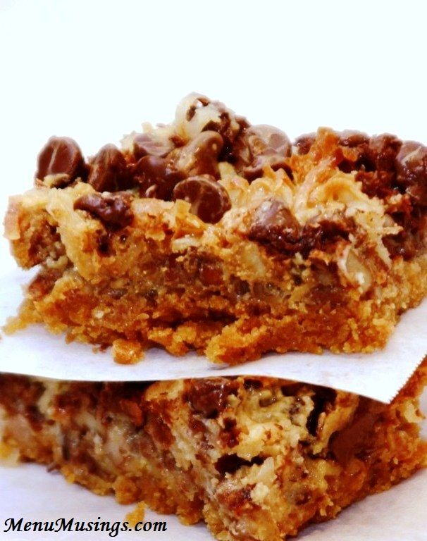 Hello Dolly Bars (aka Magic Cookie Bars)... These were created in the '60's and have endured because they are AMAZING!!! Step-by-step photo tutorial included.  (10 minutes to getting these into the oven!)