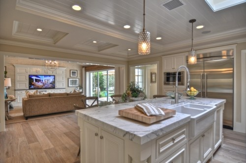 love the layout...can still interact with family in the living room (and watch tv) when cooking!