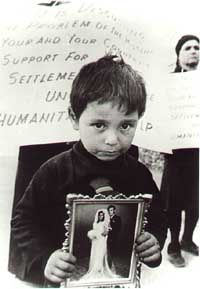 A boy looking for his missing father. Due to the 1974 Turkish invasion, 1619 Greek Cypriots, many of them civilians, were reported as missing. The bodies of some of them, found in mass graves, were recently identified through DNA testing, but the fate of many still remains unknown.