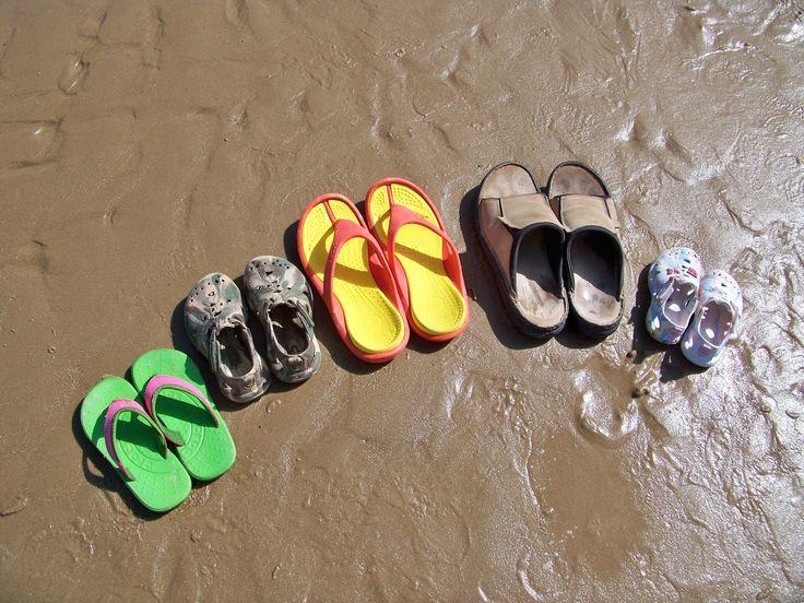 Family flip flops on Mundesley shore