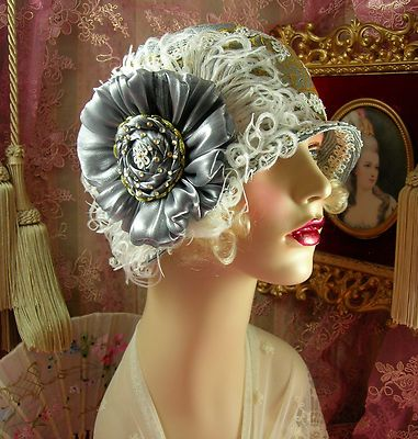 1920's vintage floral feather cloche flapper hat.