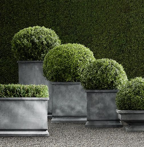 Zinc footed planter from Restoration Hardware. Great idea for porch!