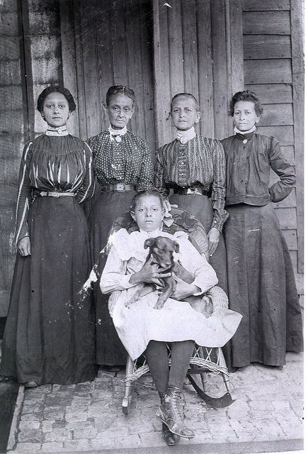 Women of Fauberg Treme, New Orleans and their dog. Faubourg Tremé is the oldest black neighborhood in America, and the origin of the southern civil rights movement and the birthplace of jazz.