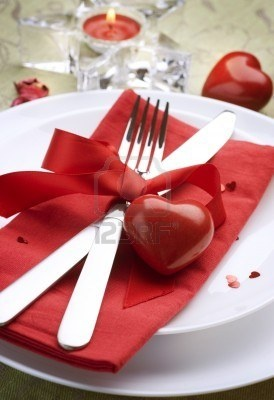 Valentine Table Setting place....  Romantic dinner ....stock photo....simple red ribbon tied with heart around table service