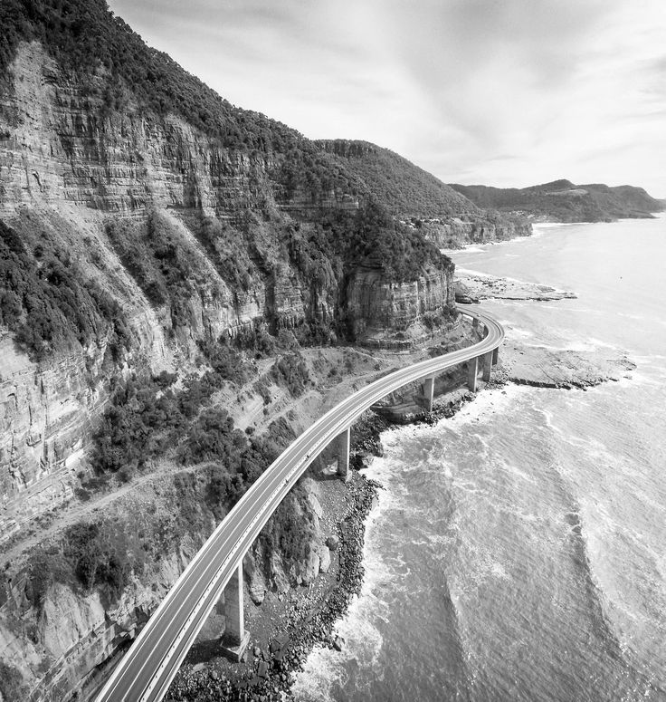 Above the Sea Cliff Bridge in Coalcliff Australia. These cliffs were mined for a century but the Grand Pacific Drive old road which went around the base of the cliff kept getting buried by landslides. Finally in 2005 the road was replaced by the bridge built out from the cliff. I had to go down to Wollongong one day to buy an amplifier off a guy (my first Orange) so I made a roadtrip of it and took the drone along. of course.