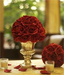 Silk Rose Wedding Centerpieces or Red Silk Rose Bridal Shower Decorations. 2 red rose kissing balls, larger sitting on a silver ceramic vase, smaller sits on table with silk rose petal table scatter at SetToCelebrate.com - Also available in Pink & White!