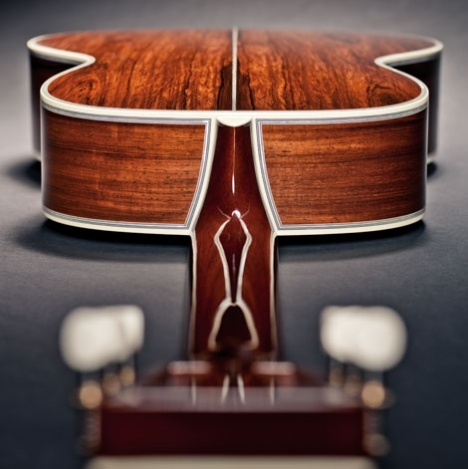 Custom body of premium Madagascar rosewood with 45-style pearl inlay  as seen from the business end of its gloss-finished solid mahogany neck.