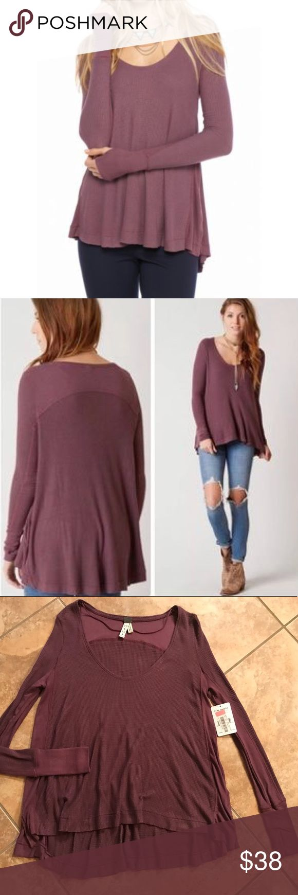 Free People Malibu Thermal Twilight Mauve NWT NWT! Free People Malibu Thermal in Twilight Mauve, a muted purple color. Cut from a supersoft thermal knit, this cozy top gets a stylish update in the form of a swingy boho back panel that adds playful volume to the casual silhouette. Definitely one of my favorite styles but I already have so many other colors! NWT (hang tag does have a sale sticker present). Free People Sweaters