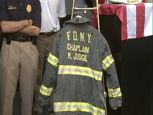 "Father Judge's coat - he was the first ""official"" death on 9/11 - he was giving last rights to someone & was hit by falling debris from above & killed instantly."