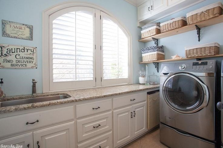 Traditional Laundry Room with High ceiling, limestone tile floors, Undermount sink, Built-in bookshelf
