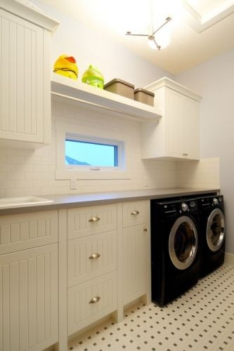 Great Laundry Room Idea; countertop over machines