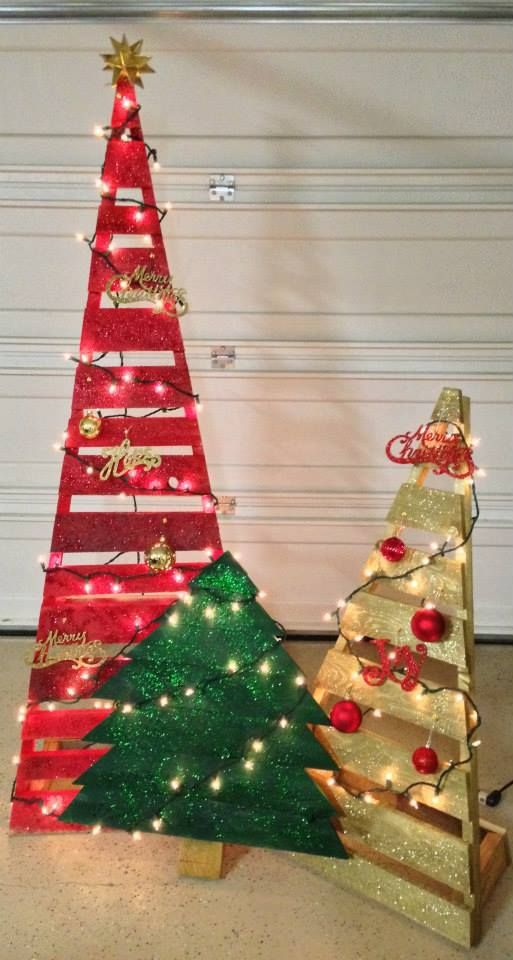 Pallet Trees, Christmas Trees. A six, four and two foot tree spray painted. I used adhesive spray to add the glitter.