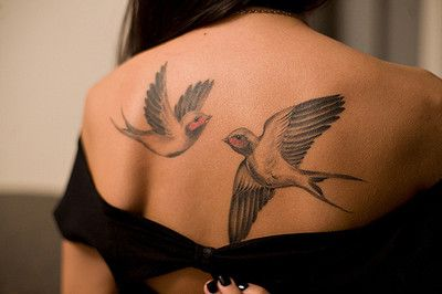 Swallow back tattoo - 50 Lovely Swallow Tattoos