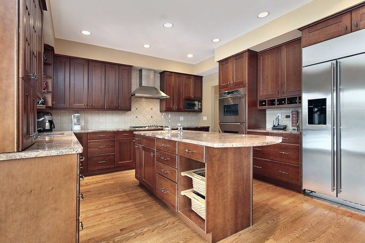 U shaped kitchen with wood cabinets and middle island for Kitchens with islands in the middle