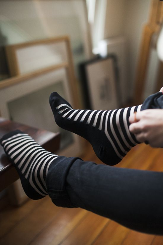 Sheer black and white socks with rolled up skinnies.