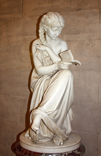 The Reading Girl by Giovanni Ciniselli (1832-1883), marble statue at Manchester Central Library in Manchester, UK