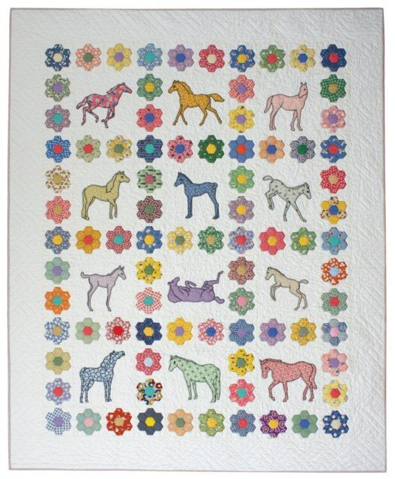 Horse quilt with hexagons.  I could use this idea with pieced blocks instead of appliqued.