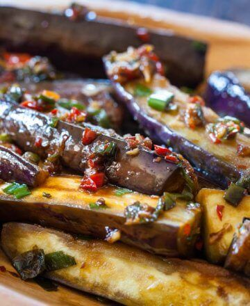 I'm not very creative when it comes to cooking eggplant, usually I poke a few holes with a fork and roast until soft. The poking is important – it prevents the eggplant from exploding in the oven. Go ahead, ask me how I know! We grow both Chinese and Japanese eggplant in the garden, both …