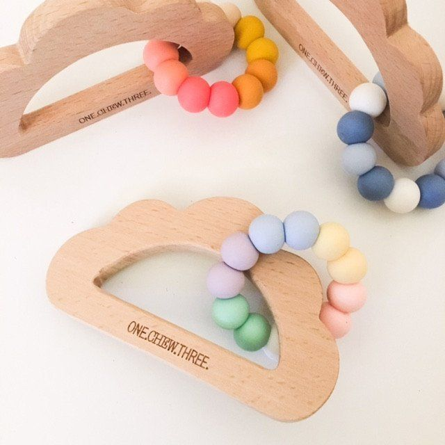 Exclusive CLOUD beechwood teether with soft, chewable silicone teething ring to soothe sore gums. Modern, natural teething relief for sore gums. Teething baby accessories that are stylish and practical
