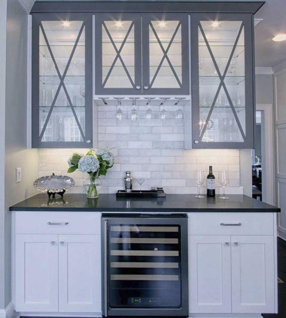 "small ""bar"" counter in kitchen incorporating wine fridge"