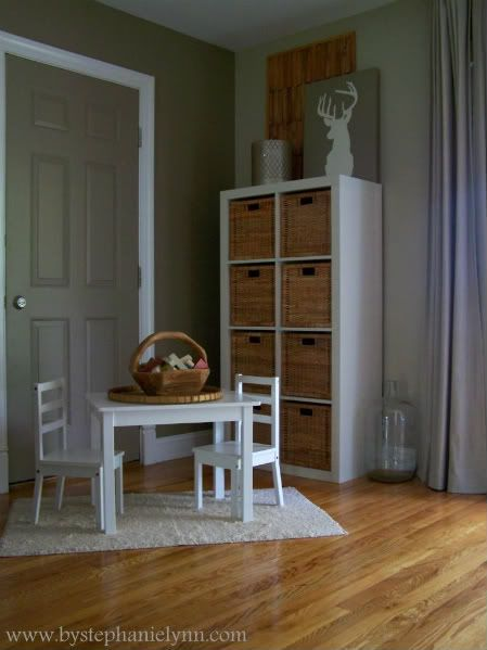 Under The Table and Dreaming: Utilizing Unused Living Room Space to Create a Child Friendly Area...Ikea expedit, baskets and love the buck silhouette