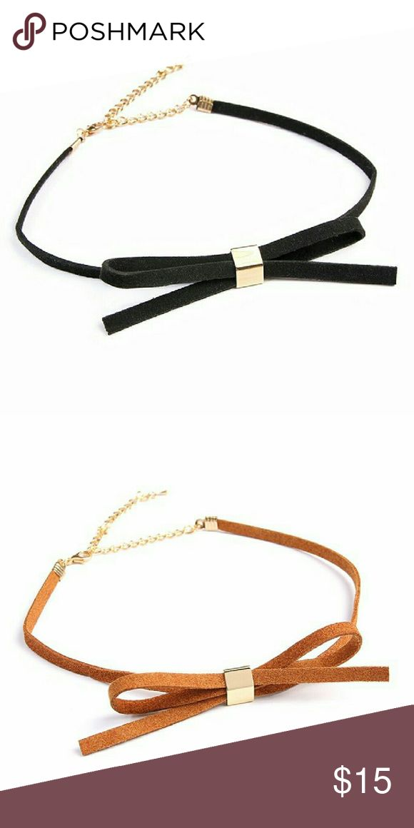 """VELVET BOW CHOKER A velvet choker featuring a bow accent in front featuring a base metal design in the center. Color: Black, Camel Material: Base Metal, PU Closure: Lobster Clasp Measurement: 4"""" Extender, 12"""" Length  *??Limit exposure to water, perfume or body cream Jewelry Necklaces"""