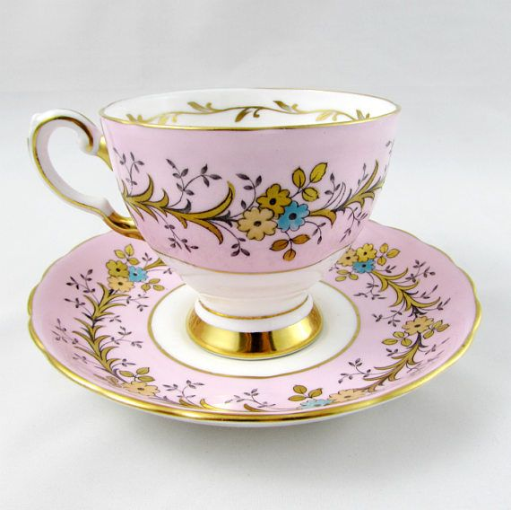 Vintage English bone china tea cup and saucer made by Tuscan. Tea cup and saucer are pale pink with flowers and gold decor. Gold tea cup handle and trimming. Great condition with no chips or cracks, but there is a small amount of crazing on the foot of the tea cup (see photos). Markings