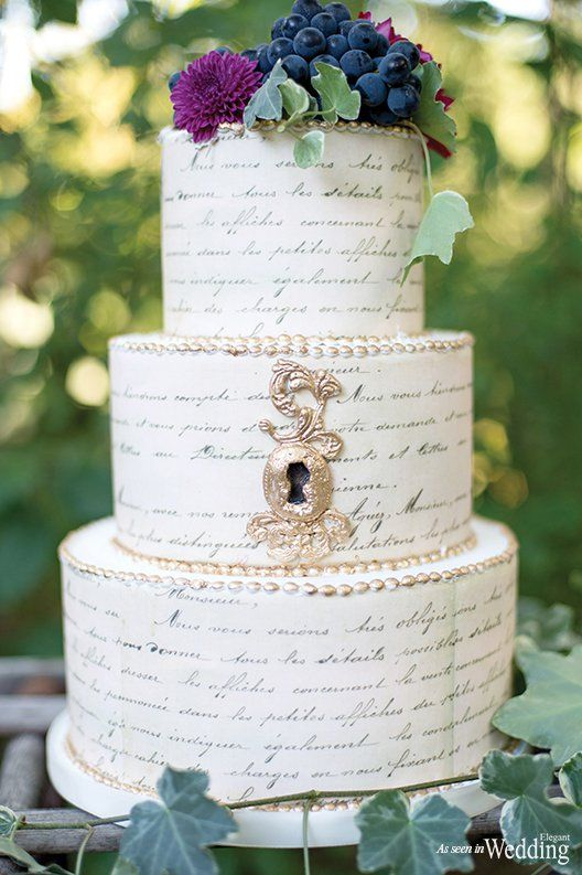 I love the key hole on the cake.   Enchanted Secret Garden | Wedding Blog