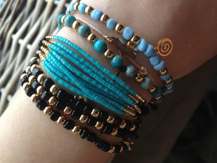 Lovely arm swag made of handmade delica miyuki turquoise and golden bracelets and black and golden sand spheres bracelets. Made with love by Maria's Ladybugs. For more of these beauties, visit our Facebook page, www.facebook.com/mariasladybugs