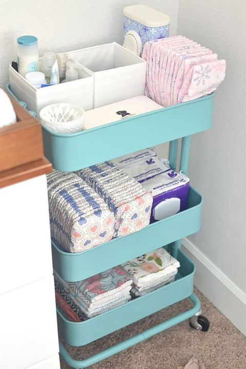 Repurpose a kitchen cart as a storage area for all of your diaper-changing needs, neatly arranging all of her wipes, diapers, toiletries, and burp cloths for easy access.  See more at Hello Baby Brown.