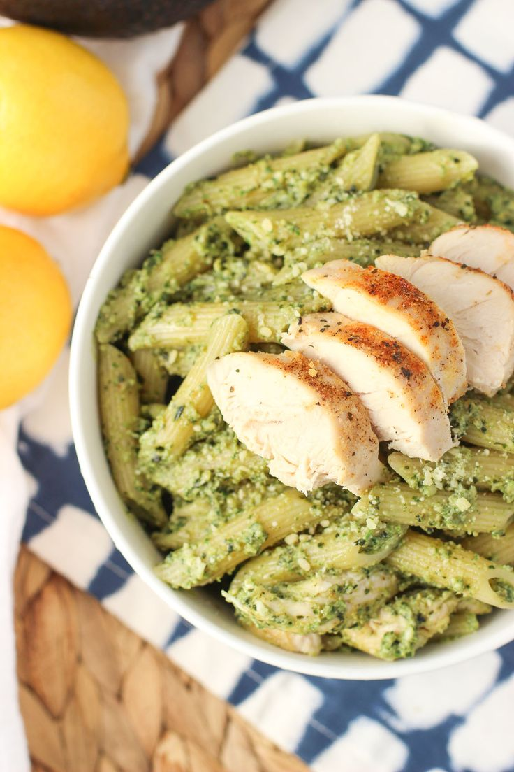 This avocado pesto pasta is packed with fresh basil, creamy avocado, and garlic for a pesto recipe with less oil. A delicious twist on a pasta favorite mixed with easy baked chicken.