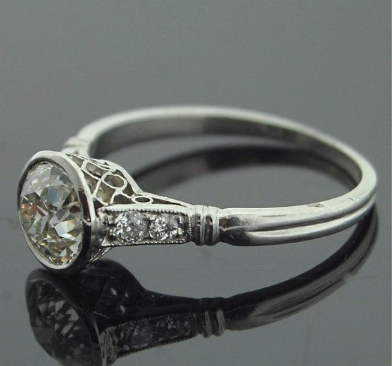 beautiful vintage platinum engagement ring. the bezel setting is timeless.