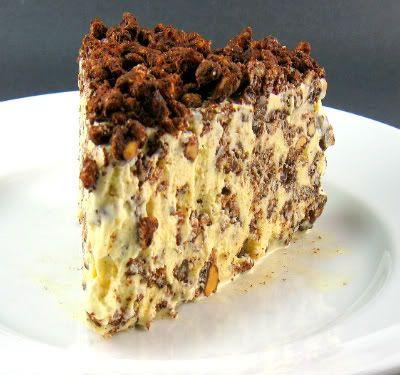 Ice Cream Crunch Cake - peanut butter, chocolate chips, rice krispies, and vanilla ice cream =]